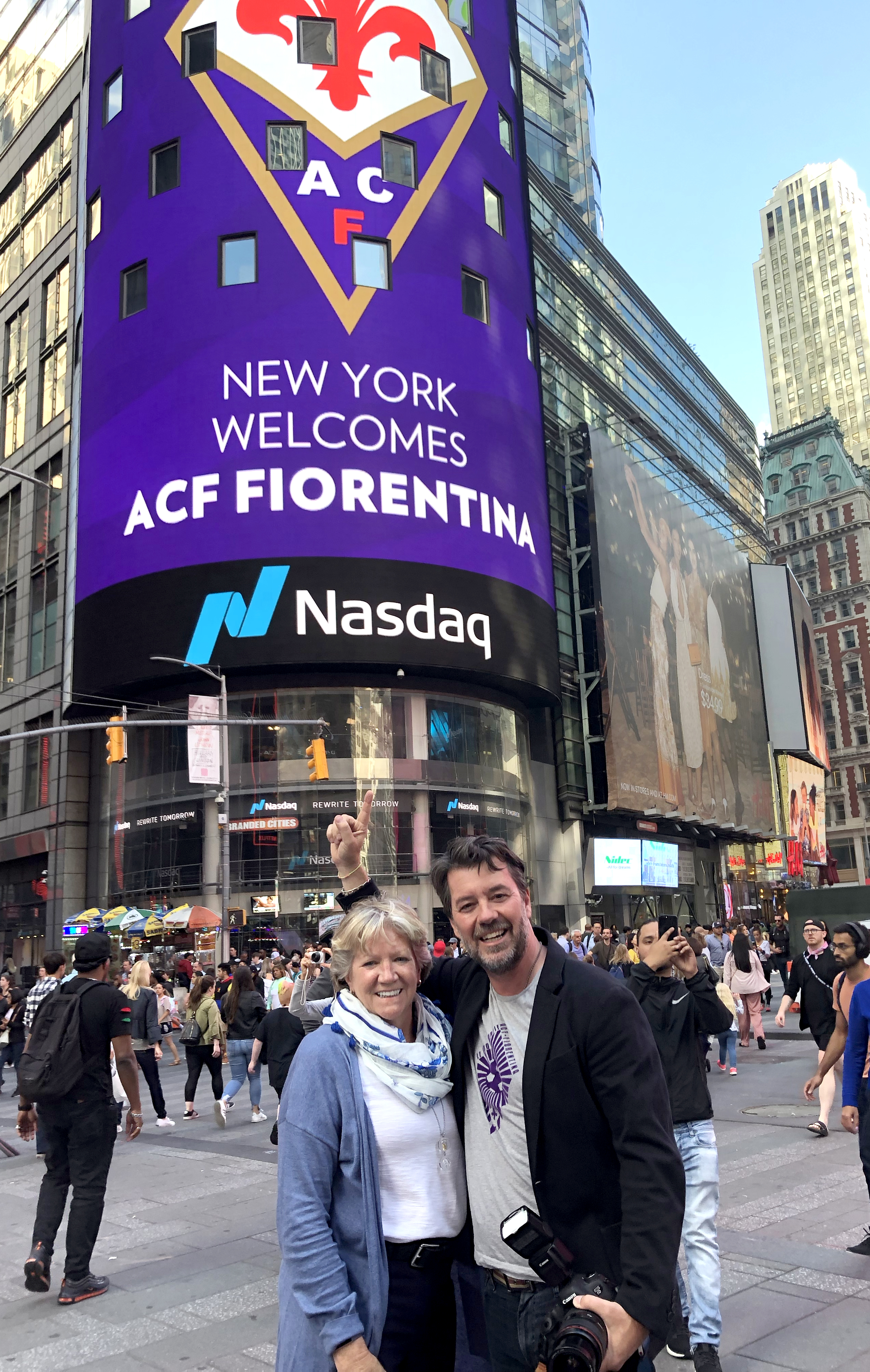 Maura and Rob show off our work on the NASDAQ video tower